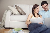 Young couple doing finances online
