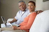 Couple using laptop for financial planning