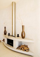 Modern fireplace with wood piles on each side