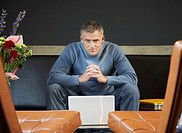 Businessman sitting with his laptop