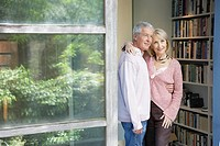 Couple in doorway by bookshelf