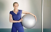 Woman holding a pilates ball