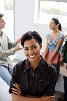 Businesswoman in office with three coworkers in background