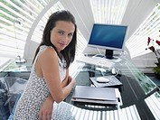 Businesswoman sitting at desk in modern office