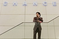 Businessman using a cell phone under Chance sign