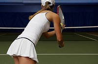 Woman tennis player ready to serve ball