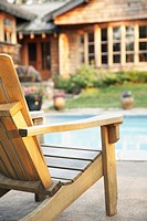 Adirondack chair near swimming pool