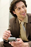 Businessman with PDA smiling