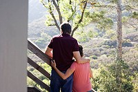 Couple embracing on staircase outdoors