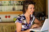 Woman sitting at laptop smiling