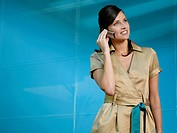 Businesswoman on mobile phone in blue office