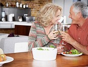 Couple with wine and salad