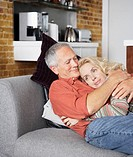 Couple embracing on sofa