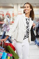 Woman in mall with shopping bags