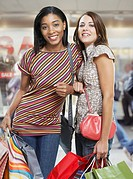 Two women in mall with shopping bags