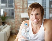 Man holding large bottle of water