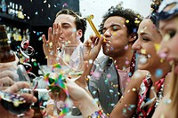 Friends at a party with confetti