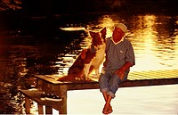 old man and dog - sitting on catwalk