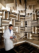 Anechoic chamber  Researcher inside an anechoic chamber, a room used for testing acoustic equipment  The protruding tiles are part of the wall of the ...