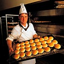 Business & professions, Food, Baker, Chef, With batch of freshly baked bread rolls,