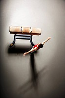 Gymnast Landing Next to Pommel Horse