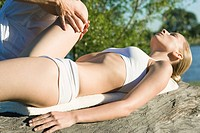 Woman receiving physical therapy outdoors