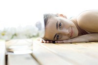 Woman lying on deck, smiling