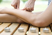 Woman receiving leg massage