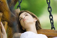 Young woman lying on swing, close-up