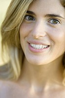 Young woman smiling at camera, portrait (thumbnail)