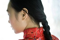 Young woman with hair braided, close-up, rear view