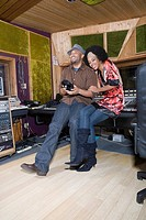 Producer and musician in recording studio (thumbnail)
