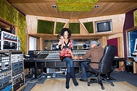 Producer and musician in recording studio