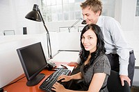 Businesswoman and businessman at desk