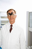 Male doctor wearing magnifying glasses