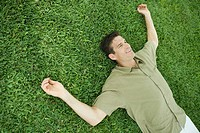 Man lying on grass, smiling
