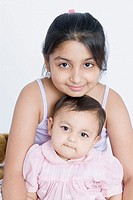Portrait of a girl sitting with her sister
