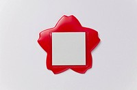 Adhesive note in plastic red holder
