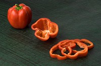 Close-up of a red bell pepper with slices