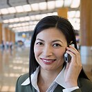 Portrait of a businesswoman talking on a mobile phone at an airport