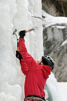 A young man finds solid ice on his way up a run at Marble Canyon, British Columbia, Canada