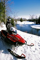A snowmobiler cruised through a wooded trail on the Bruce Peninsula, Ontario, Canada