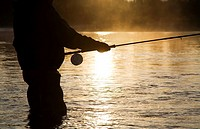 Flyfisherman at sunsrise, Bulkley river, Smithers, British Columbia, Canada