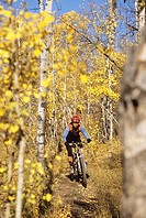 young female mountain biking in the front range Canadian Rockies, Alberta, Canada