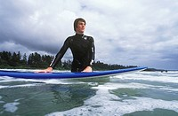 Teenage boy surfing at Long Beach, Pacific Rim National Park, near Tofino, British Columbia, Canada