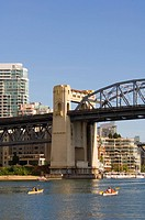 Kayaks and Burrard street bridges, British Columbia, Canada