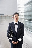 Portrait of a female pilot standing