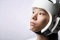 Close-up of a young woman wearing a sports helmet