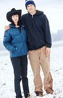 Man and Woman Posing in Snowy Field