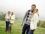 Germany, Baden-Württemberg, Swabian mountains, Smiling couples hugging each other